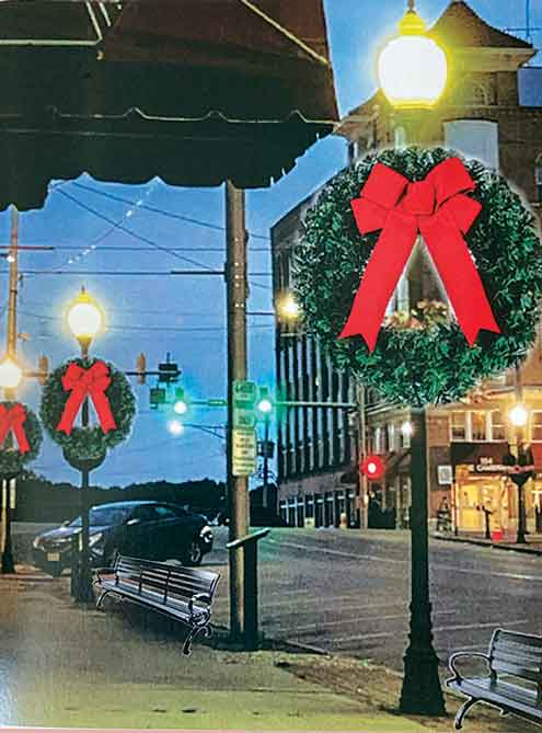 Pictured is a depiction of how a new plan for decorating downtown Jackson will look this year and beyond. The plan calls for the use of the existing period lighting, along with newly purchased wreaths which will be placed on those light poles. New black metal benches will also be placed along the sidewalks. A private fundraising campaign is already under way. (Photo Courtesy of the Downtown Park and Improvement Committee)